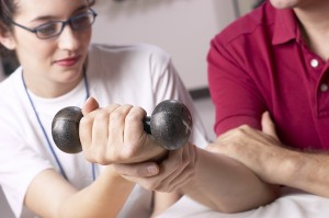 woman and man dumbell hand