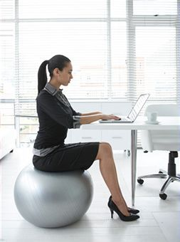 working woman on yoga ball chair 2