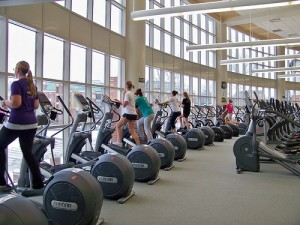 people doing exercise on Elliptical machine 11