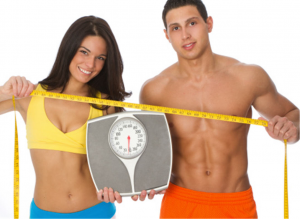 couple holding scale