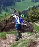 man lifting bike