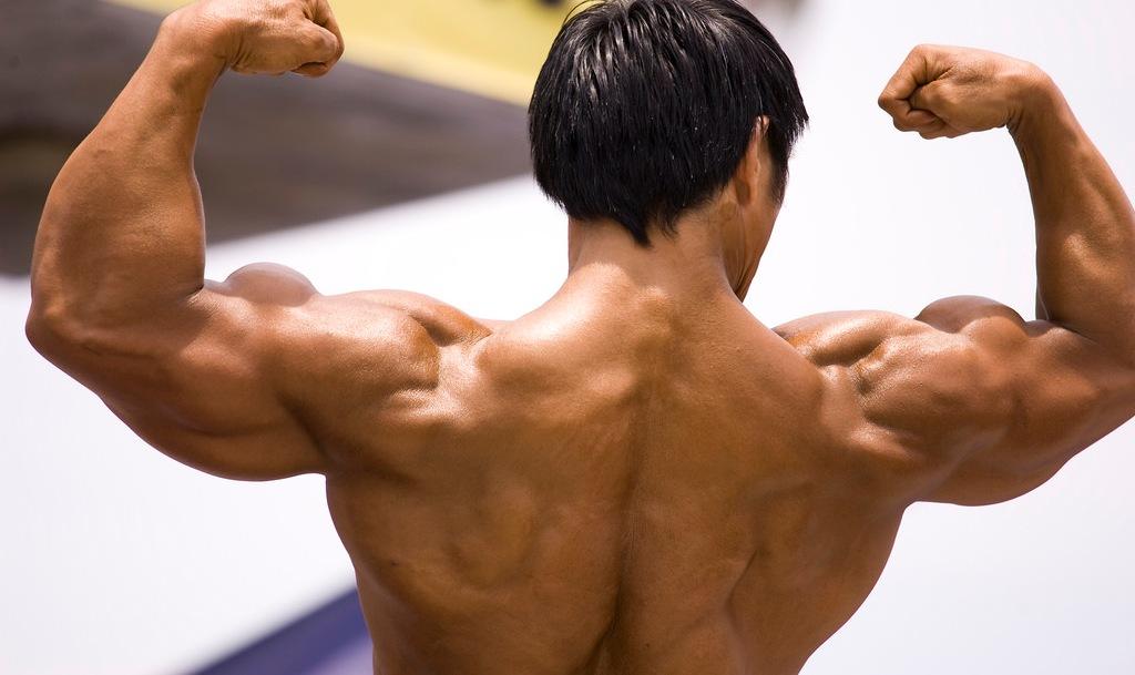 muscular man showing arm