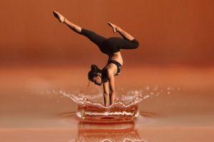 woman doing health retreat yoga